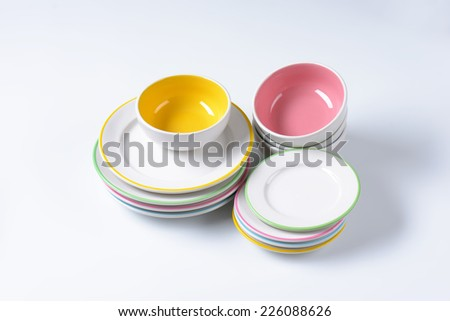 set of porcelain dishes, bowls and plates