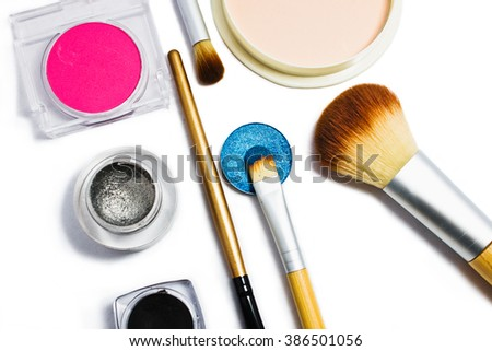 Set of professional cosmetics for make-up isolated on white background . Cosmetic products for makeup. - stock photo