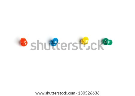 Set of push pins in different colors, with real shadows, isolated on white background. - stock photo