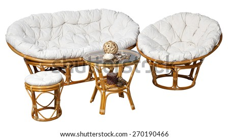Set of rattan furniture for balcony and garden on artificial grass isolated on white background with clipping path - stock photo