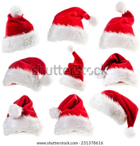 Set of red Santa Claus hats - stock photo