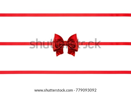 Set of red xmas satin ribbon bow and three ribbons isolated on white background