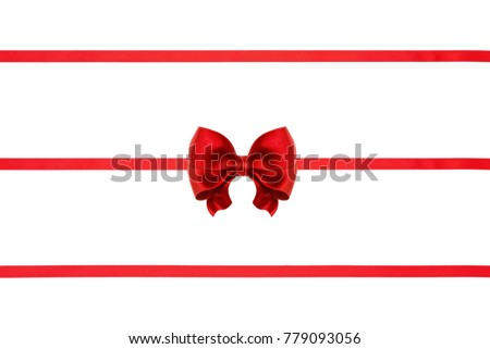Set of red xmas silk ribbon bow and three ribbons isolated on white background