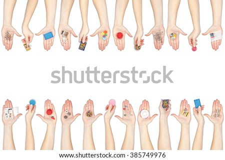 set of sewing tools and supplies in a hands isolated on white background - stock photo