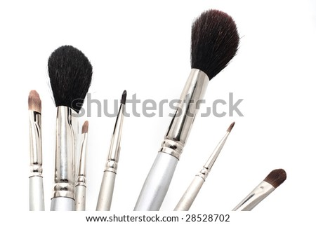 Set of silver cosmetic brushes - stock photo