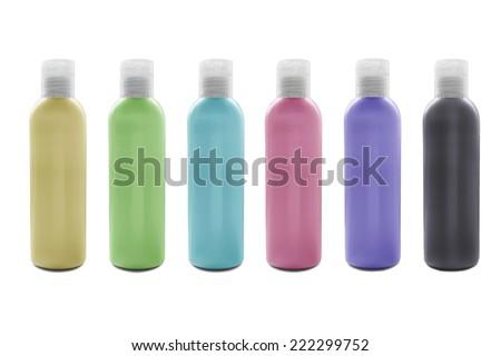 Set of six blank shampoo bottles on white background - stock photo