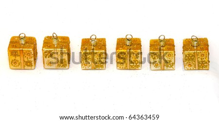 Set of six golden Christmas ornaments in gift shape