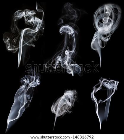 set of smokes on black background - stock photo