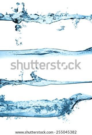 Set of splashing water waves, isolated on the white background. - stock photo