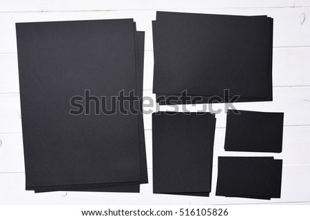 set of stacks of black paper different sizes