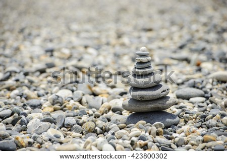 Set of stones and pebbles stacked and balanced on top of each other - stock photo