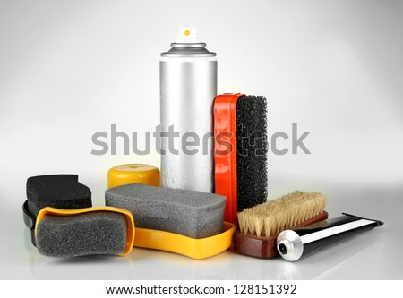 Set of stuff for cleaning and polish shoes, isolated on  white - stock photo