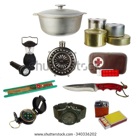 Set of survival and tourist equipment. Isolated on white - stock photo