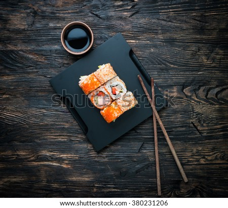 set of sushi rolls with soy and chopsticks - stock photo