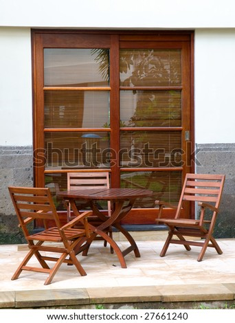 Set of table in the back yard of villa - stock photo