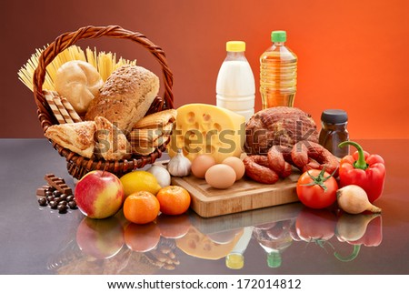 Set of tasty groceries on mirrored table.  - stock photo