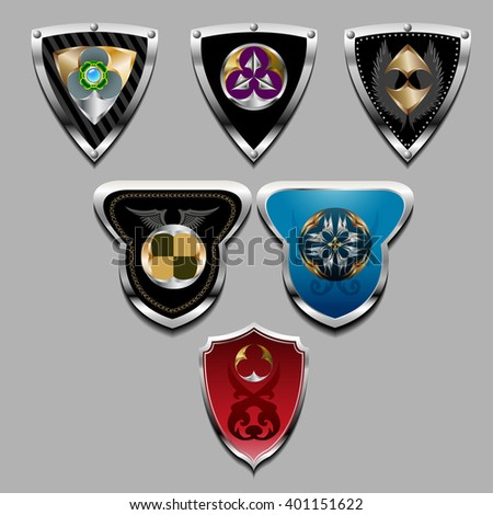 Set of the steel chrome-plated shields with a various decorative pattern. - stock photo
