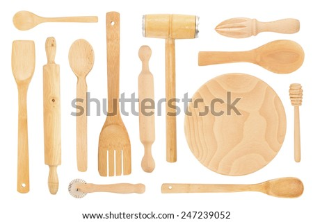 Set of the wooden kitchen utensils on a white background