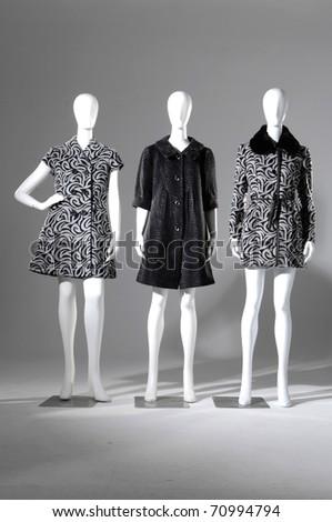 Set of Three dummies dressed in coat - stock photo
