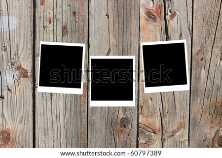 set of three old blank frames lying on a wood surface