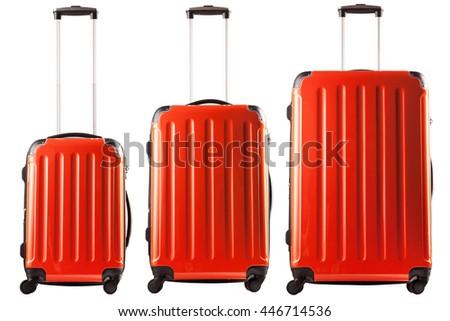 Set of three orange plastic suitcases isolated on white background - stock photo