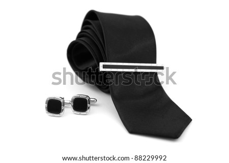 Set of tie and cufflinks on a white background - stock photo
