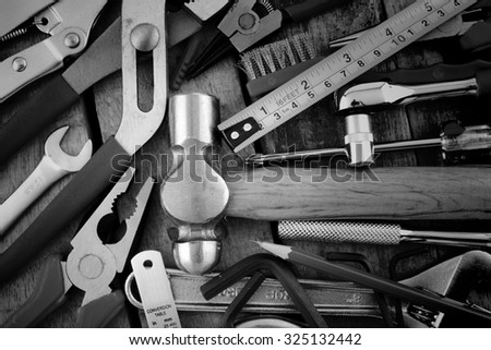 Set of tools a wood panel on black and white - stock photo