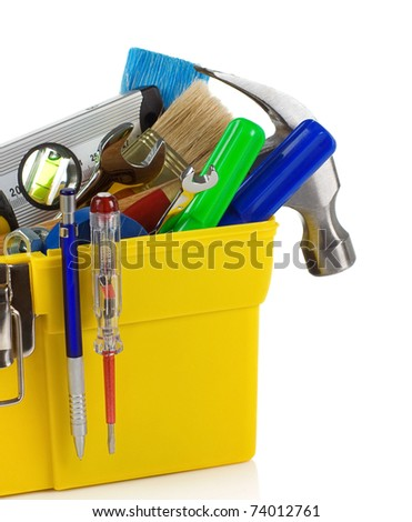set of tools and instruments in yellow plastic box isolated on white background - stock photo