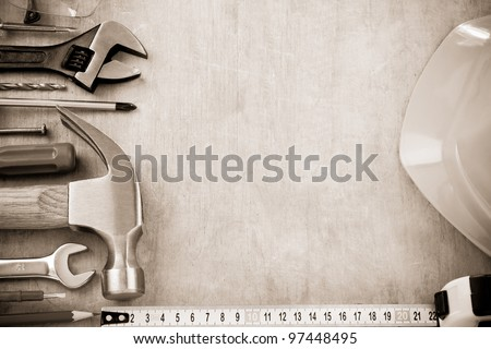 set of tools and instruments on wood texture background - stock photo