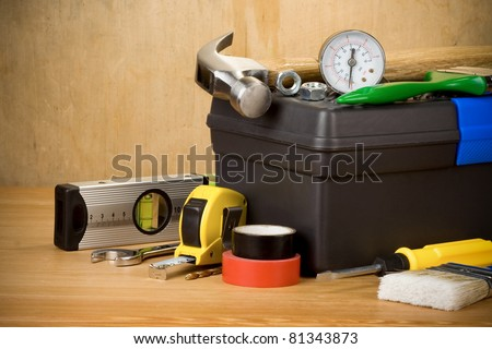 set of tools and toolbox on wood texture - stock photo