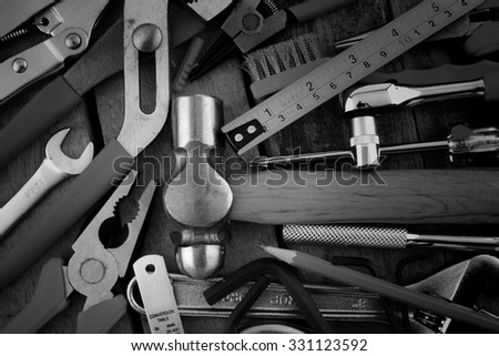 Set of tools Effect filter Film Grain by Photoshop a wood panel on black and white - stock photo