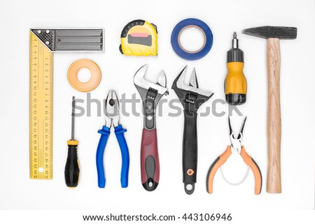 set of tools: hammer, screwdriver, pliers, adjustable wrench, measuring tape, ruler. top view