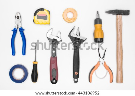 set of tools: hammer, screwdriver, pliers, adjustable wrench, measuring tape. top view