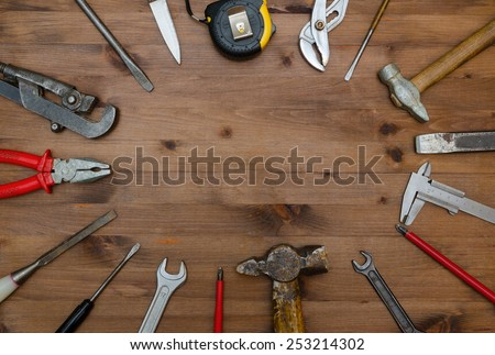 Set of tools on old wooden table. - stock photo