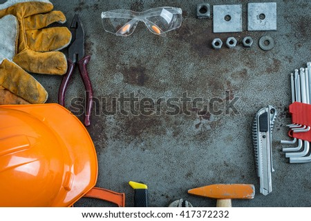 Set of tools on rusty metal with copy space  in center - stock photo
