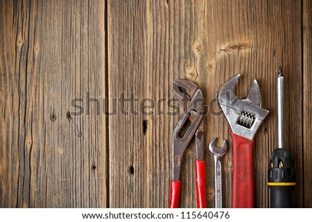 Set of tools on the wood background - stock photo