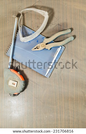set of tools under a layer dust on the table - stock photo