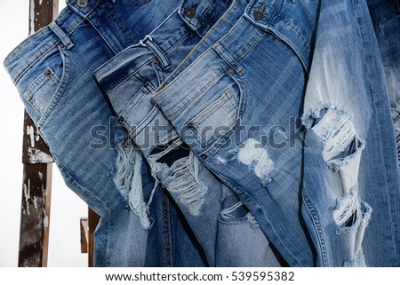 Set of torn four jeans with wooden ladders