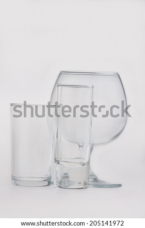 Set of transparent glass goblets isolated on white background - stock photo