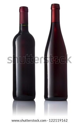 Set of two green bottles with red wine on a white isolated background. - stock photo