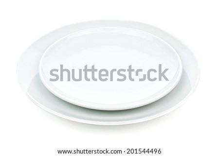 Set of two round, white serving plates isolated on white           - stock photo
