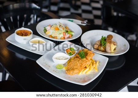 set of variety foods on the restaurant table - stock photo