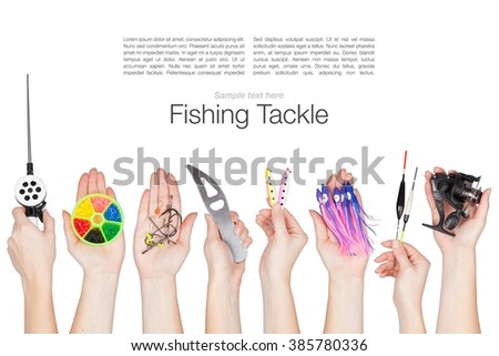 set of various fishing tackle in a hands isolated on white background - stock photo