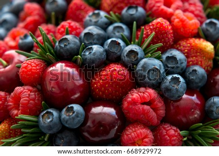 Set of various fresh summer berries.  Mix of raspberries, blueberries, cherries, strawberries, blueberries. Close up, selective focus.