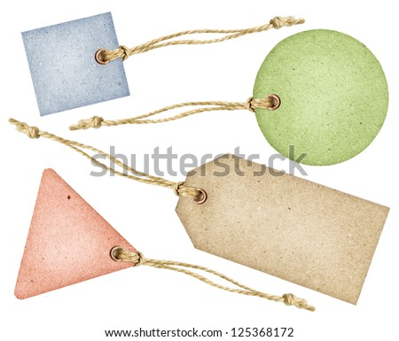 Set of various grungy color aged paper tags with metal rivets and simple traditional strings, isolated over white background - stock photo