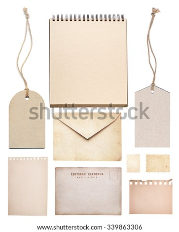 set of various old paper sheets, postcard, stamp, envelope, tag, notepad isolated on white background. - stock photo