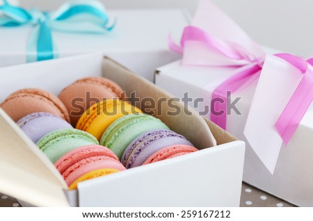 Set of various pastel colored macaroon and gift boxes with ribbon and bow - stock photo