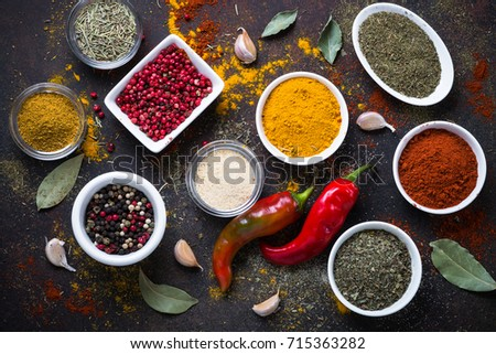 Set of Various spices in a bowls on stone table. Top view.