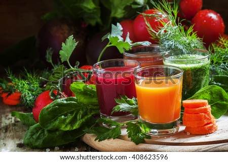 Set of vegetable juice in glasses: beetroot, tomato, spinach, carrots, herbs and fresh vegetables on a vintage wooden background, selective focus - stock photo