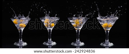Set of Vermouth cocktail inside martini glass over dark background